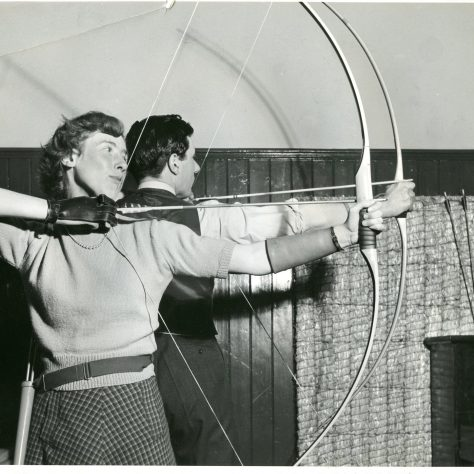 Male and female archer with bows ready to loose their arrows. Black and White Image. | Image courtesy of University of Westminster Archives