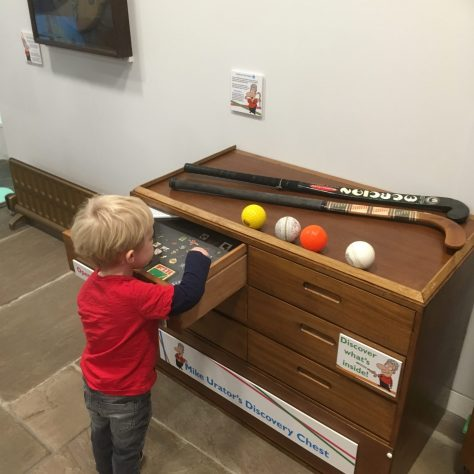 Young boy admires hockey display | Courtesy of The Hockey Museum