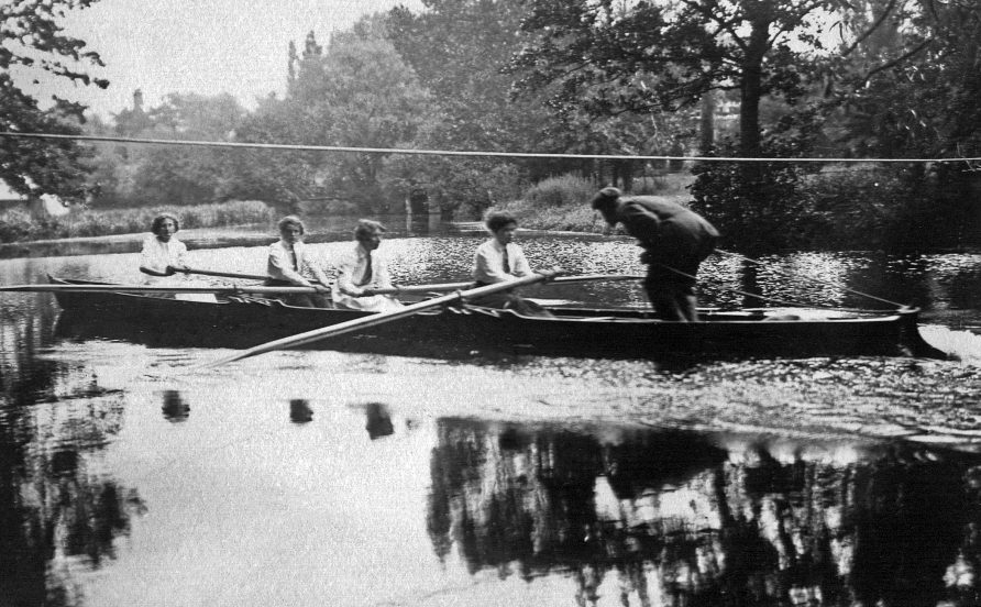 Female rowing team spurred on by their coach   St Hilda's College Archive