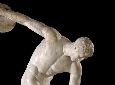 Marble carved statue depicting a man preparing to throw a discus | The British Museum