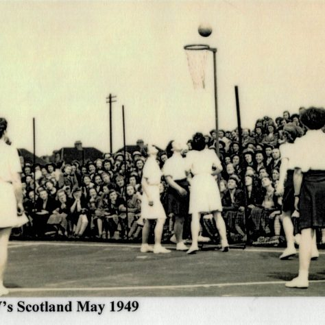Black and white photograph of 1st International Netball game, England v Scotland teams around net, May 1949. |  England Netball Heritage Archive