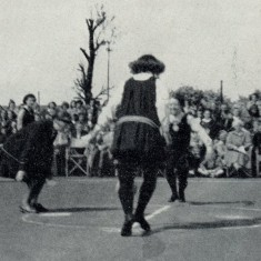 Girls re-enacting the 1936 Netball Rules, starting the match by tossing the ball between the two centres (1951). |  England Netball Heritage Archive