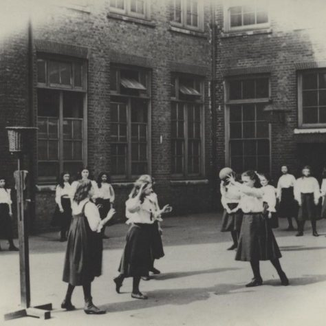 Photo from the first years of Netball, showing baskets on poles and teams wearing gymslips. Circa 1897 |  England Netball Heritage Archive