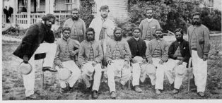Tom Wills (standing at back wearing a cap) with his aboriginal cricket team in 1866 outside the Melbourne Cricket Ground. | Courtesy of Greg de Moore