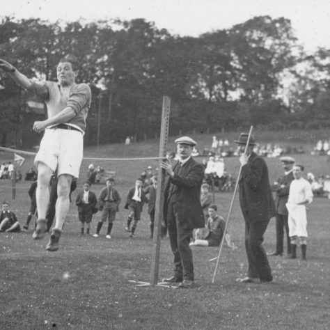 Black and white photo of a man performing a high jump at the Gartloch Sports Day | Image courtesy of NHS Greater Glasgow and Clyde Archives