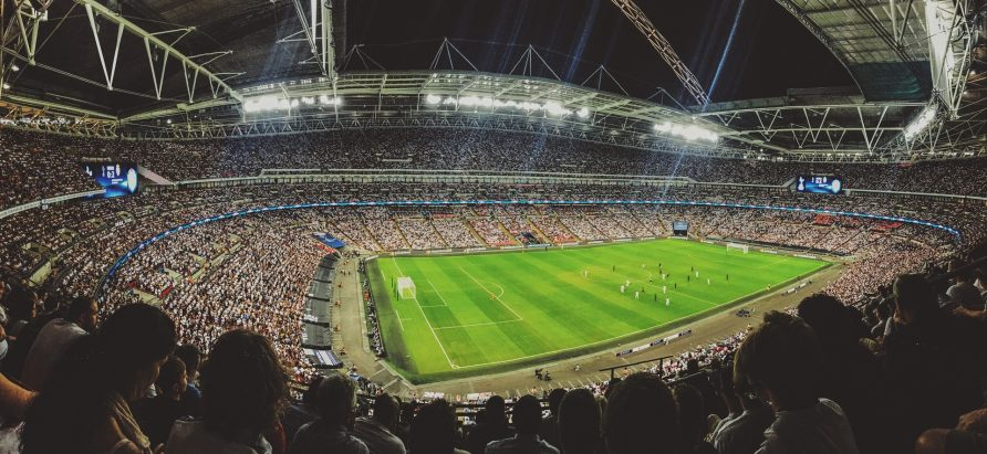 Wide angle view of Wembley Statium from an upper stand | Mitch Rosen / Unsplash
