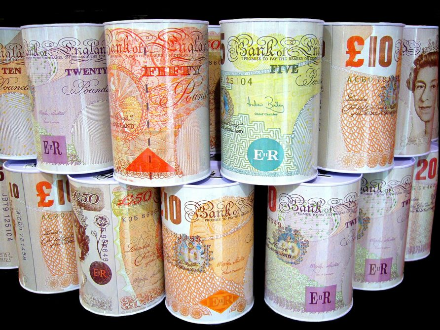 Stacked money boxes featuring the designs of various British Sterling notes | Shirley810 / Pixabay