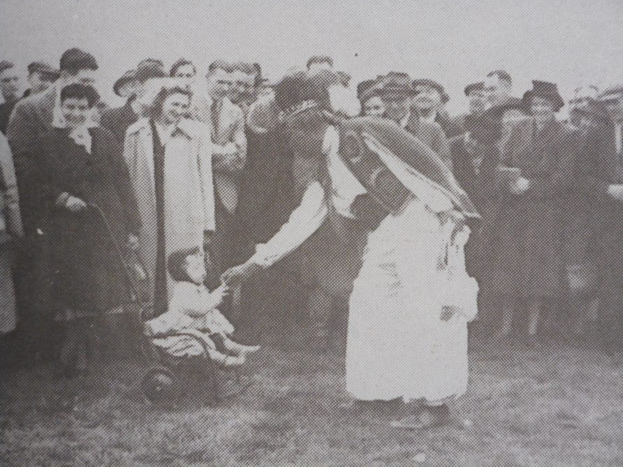 Ras Prince Monolulu entertains the crowd at Warwick Racecourse. Image from 'Bygone Warwickshire: A Photo History of our County', Leamington Spa Courier. | Warwickshire County Record Office reference PH557/page 20