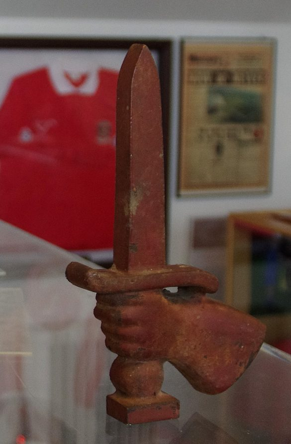 Hand gripping a sword carving | The Charlton Athletic Museum