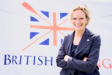 Annamarie Phelps CBE stands in front of the British Rowing logo | Courtesy of Annamarie Phelps CBE