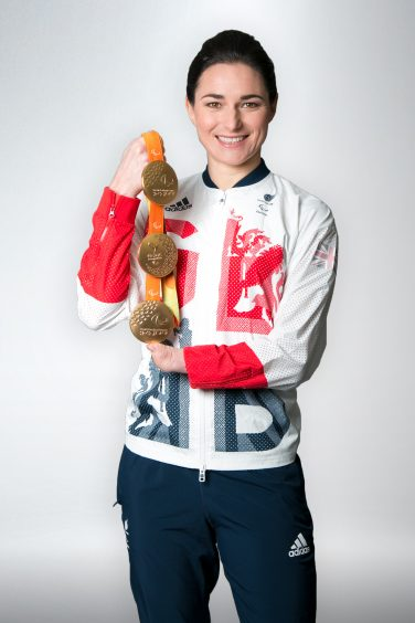 Dame Sarah Storey DBE with three gold medals | Courtesy of Dame Sarah Storey DBE
