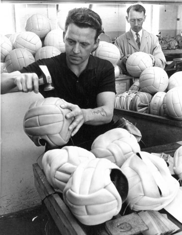 Black and white image of men hand-making footballs | Wakefield Museums