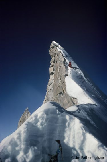 Peak of a mountain covered in snow set against a dark blue sky | Keswick Museum