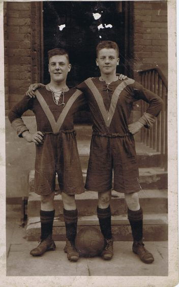 Sepia photo of two men in football gear with a pig skin football between them | Courtesy of Green Howards Museum
