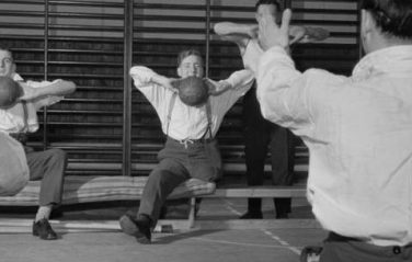 Black and white photo of men undergoing physiotherapy as part of rehabilitation | Image courtesy of the Imperial War Museum