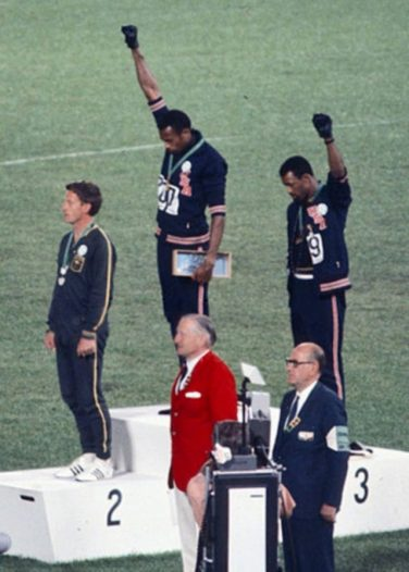 Peter Norman, Tommie Smith and John Carlos, on the podium at the1968 Olympics | Angelo Cozzi (Mondadori Publishers) [Public domain]