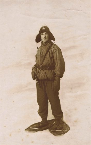Sepia image of a man in thermal gear and snowshoes   Army Museums