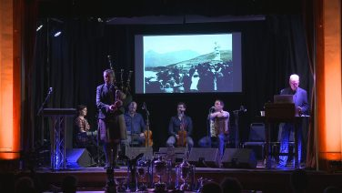 A band performing on stage with Duncan MacGillivray playing the bagpipes | Courtesy of Hugh Dan MacLennan