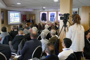 Camera operator recording the crowd and speaker at a Sporting Heritage seminar   Sporting Heritage