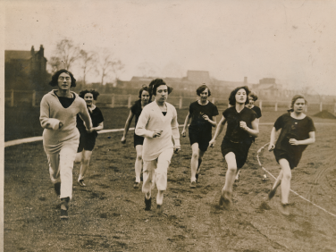 Sepia image of 8 women running on a track | Courtesy of Birchfield Harriers