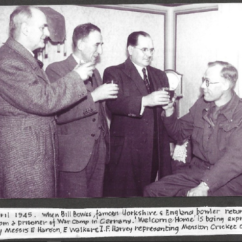 Cricketer Bill Bowes at Menston cricket club with other club members in the club house. | Menston Cricket Club