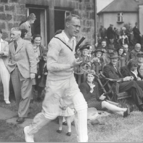 Cricketer coming out to bat. | Menston Cricket Club