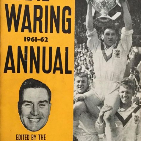 Cover of an Eddie Waring Annual with a black and white photo of a player lifting a trophy   Dewsbury Memories
