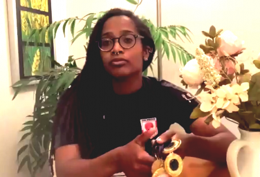 Image of Greer-Aylece Robinson with flowers | Girls United FA