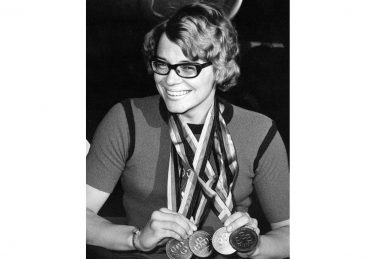 Black and white photo of Carol Bryant with her four gold medals   @ Caz Walton