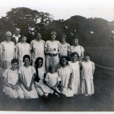 Black and white team photo of the Chiddingstone Causeway Stoolball team and their coach | Stoolball England