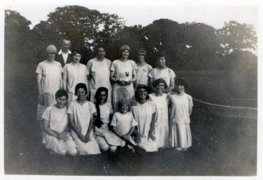 Black and white team photo of the Chiddingstone Causeway Stoolball team and their coach   Sussex Archaelogical Society