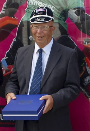 Christopher Ottaway, descendent of Harry Haslam, wearing the honours cap commemorating his relative's hockey appearances (caps) for Great Britain.  | The Hockey Museum