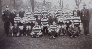 The Glamorgan Police Team, 1913. Dick Thomas is seated third from the right wearing scrum cap. | South Wales Police Heritage Centre