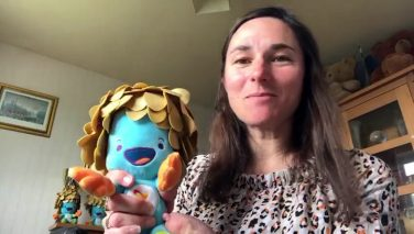 Dame Sarah Storey DBE holding a blue stuffed toy | Sporting Heritage CIC