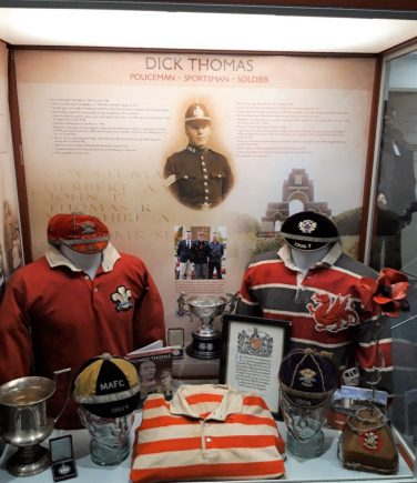 A display showing the shirts and caps worn by Dick Thomas | South Wales Police Heritage Centre