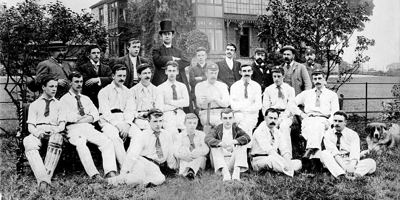 Black and white team photo of St Aidan's cricket club with many men in their whites | North Leeds Cricket Club