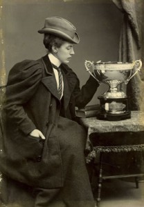 Black and white photo of Amy Pascoe with a trophy | Surrey History Centre