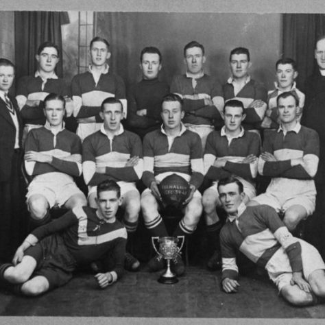 Black and white football team photo with a trophy | Fermanagh County Museum