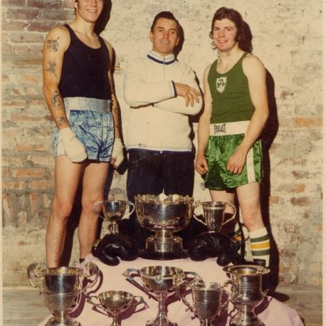 Colour photograph of three men posing in front of eight trophies | Fermanagh County Museum