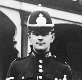 Black and white image of police officer