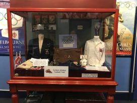 Museum display case full of items from the DAFT collection